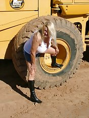 Always curious I found this front end loader a great place to explore  and perfect place to let the sun warm my big bare tits